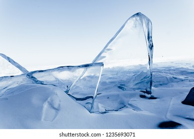 Blocks of ice gleaming in the sun. Arctic winter background.