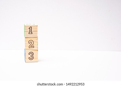 """123"" blocks isolated against white"
