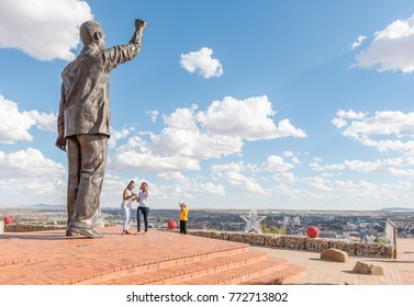 BLOEMFONTEIN, SOUTH AFRICA, DECEMBER 11, 2016: Unidentified visitors at the 6.5m bronze statue of Nelson Mandela on Naval hill in Bloemfontein