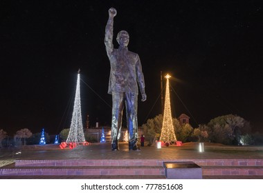 BLOEMFONTEIN, SOUTH AFRICA, DECEMBER 15, 2016: The 6.5m bronze statue of Nelson Mandela at night surrounded by Christmas decorations on Naval hill in Bloemfontein