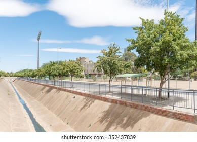 BLOEMFONTEIN, SOUTH AFRICA - DECEMBER 16, 2015: Paved river with the Mangaung Oval in Bloemfontein, home to the Knights, the Free State team participating in all the professional cricket tournaments