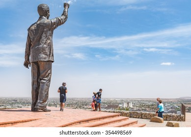 BLOEMFONTEIN, SOUTH AFRICA, DECEMBER 21, 2015: The 6.5m bronze statue of Nelson Mandela on Naval hill in Bloemfontein. Waaihoek, where the ANC was founded, is next to the cooling towers in the back