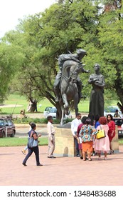 Bloemfontein / South Africa - February 20th 2019: People at one of the statues at the Women's Monument or Vrouemonument in Bloemfontein""