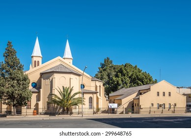 BLOEMFONTEIN, SOUTH AFRICA - JULY 19, 2015: The twin-spired Dutch Reformed Church in Bloemfontein was consecrated on 7 May 1880. The church hall is to the right
