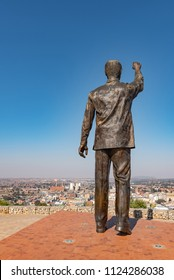 BLOEMFONTEIN, SOUTH AFRICA, JUNE 27, 2018: The 6.5m bronze statue of Nelson Mandela on Naval hill guarding over Bloemfontein