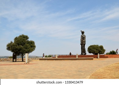 BLOEMFONTEIN, SOUTH AFRICA - October 2, 2018: The eight meter tall statue of Nelson Mandela at Naval Hill, overlooking the city of Bloemfontein, in the Free State province of South Africa.