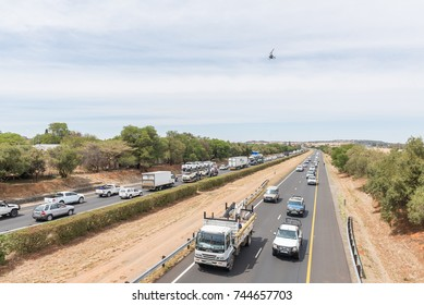 BLOEMFONTEIN, SOUTH AFRICA - OCTOBER 30, 2017: Protesters disrupting traffic on the N1-highway at Bloemfontein in protest against farm attacks in which more than 1000 farmers were murdered since 2004