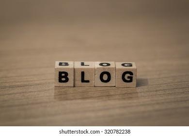 Blog written in wooden cubes on a desk