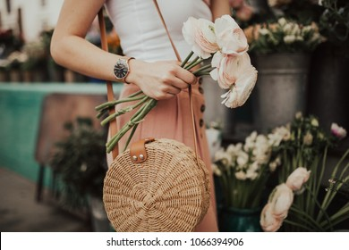 Blogger girl holding a bunch of flowers at the flower market. Blogging concept. - Shutterstock ID 1066394906