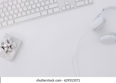 Bloggers desk concept - Flat lay headphones and computer keyboard.White