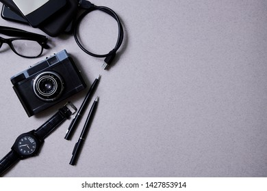 Blogging, blog and blogger or social media concept: retro photo camera and accessories for bloger. Flat lay