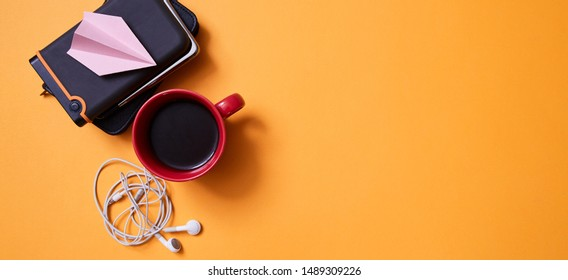 Blogging and traveling. Freelance work, adventure and exploration concept. Coffee, a hard disk on a yellow background
