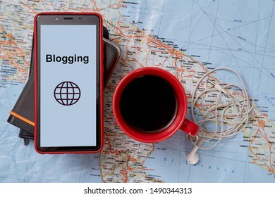 Blogging and traveling. Freelance work, adventure and exploration concept. A Cup of coffee and hard drives on the map.