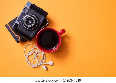 Blogging and traveling. Freelance work, adventure and exploration concept. Vintage camera and a Cup of coffee
