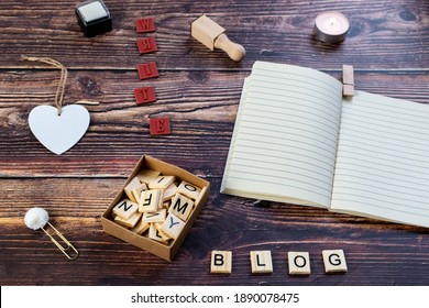 blogging or writing theme photo idea with notepad and rustic wooden table background