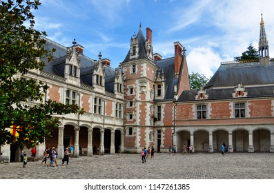 Blois / France — August 12, 2012: the yard of Chateau de Blois, one of the most famous castles of Loire Valley, France. A former kings residence, it is currently popular tourist attraction