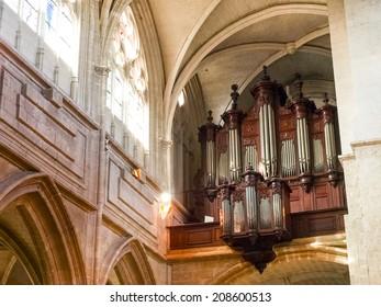 Blois, France - June 8, 2014: Saint-Louis de Blois. Detail of Catterale with the organ pipes near window