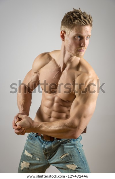 Blond athletic man with abdominal muscle
