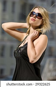 blond beautiful gorgeous woman in sunglasses takes a warm of sun
