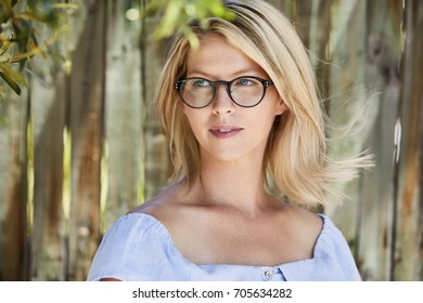 Blond beautiful woman in glasses, looking away