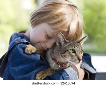 Blond boy with oriental bred cat (series Children, Animals)