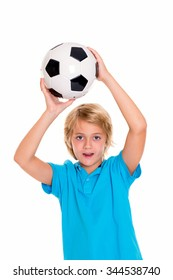blond boy with soccer ball in front of white background