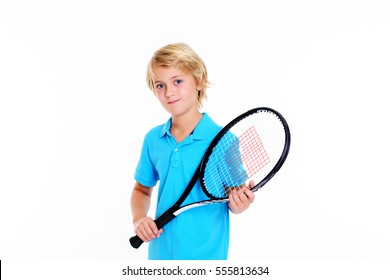 blond boy with tennis racket in front of white background