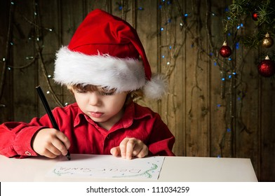 Blond boy writes a letter to Santa