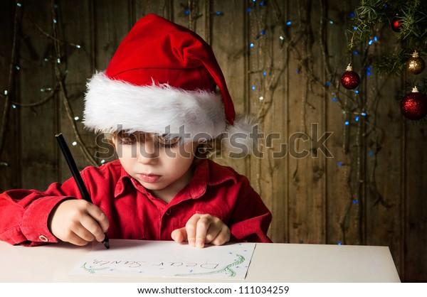 Blond boy writes a letter to Santa