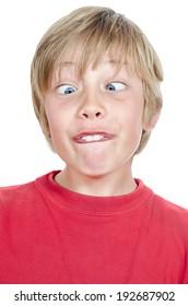 blond boy's portrait making silly expression