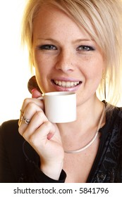 Blond business woman relaxing with coffee