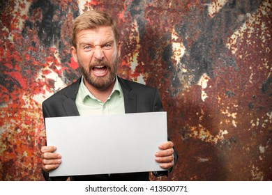 blond businessman angry expression