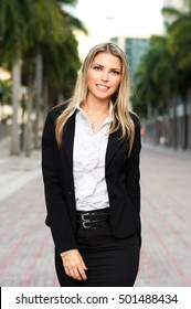 Blond businesswoman in downtown business district