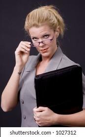 Blond businesswoman executive with portfolio