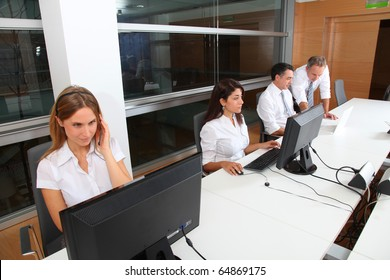 Blond businesswoman with headset on