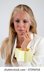 Blond businesswoman with post-it-note bracelet