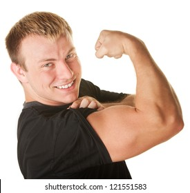 Blond Caucasian man over white background flexing biceps muscle