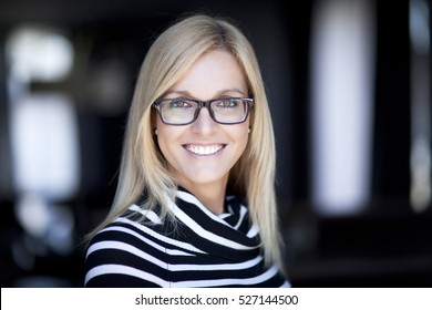 Blond Confident Woman Working At Home. With Glasses.