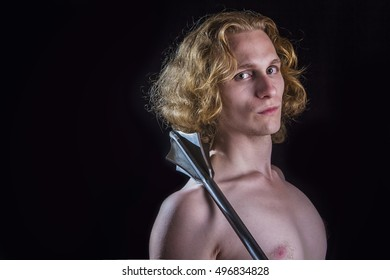 Blond curly knight holding a medieval weapon, a mace, nude upper body
