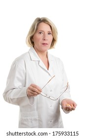 Blond Doctor with different tablets looking skeptical, isolated on white, copy space