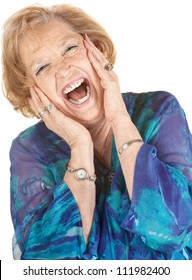 Blond elderly woman yelling with hands on her cheeks