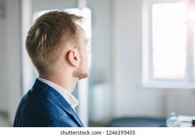 Blond European businessman in the office. Concept successful future