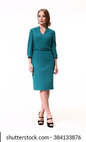blond fashion business woman with up do hair in formal office blue dress high heels shoes standing full body portrait isolate on white