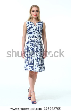 2429c7dd011e88 blond fashion model business executive woman in summer printed floral sleeveless  dress high heel shoes standing