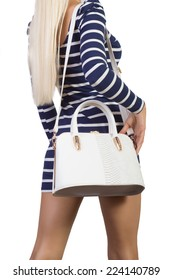 Blond female with leather bag