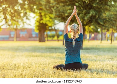 Blond Female In Lotus Position Arms Up