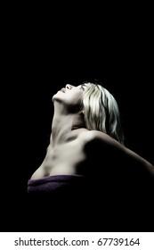 blond female posing on black background