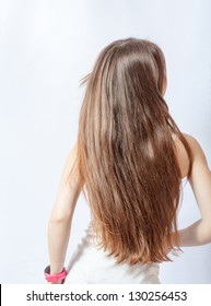 blond flying hair back view on gray background