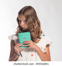 blond girl with blue turquoise notebook and pen on a white background