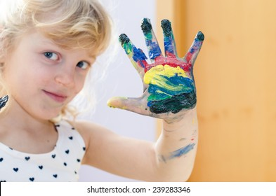 blond girl with colorful painted hand